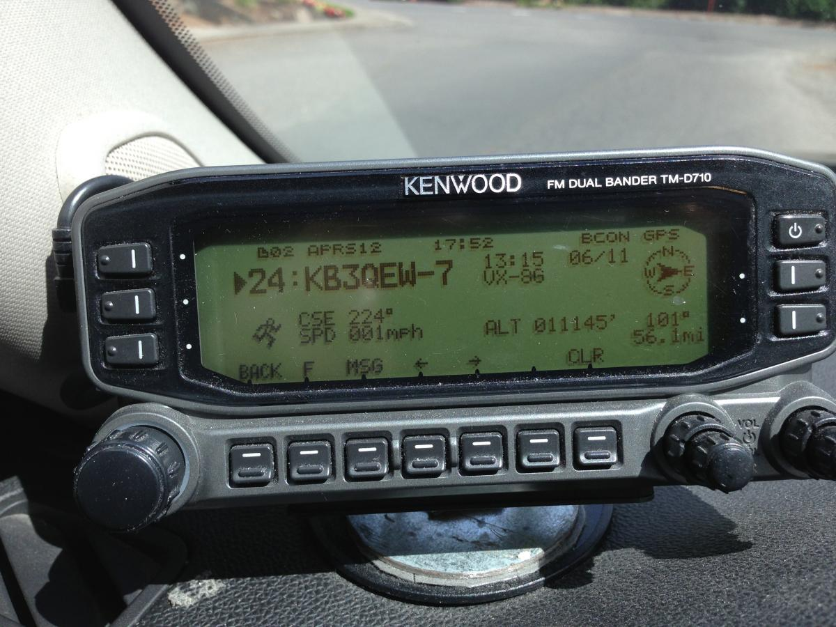 John N7AAM's photo of his mobile unit displaying KB3QEW's APRS beacon at 11,145'