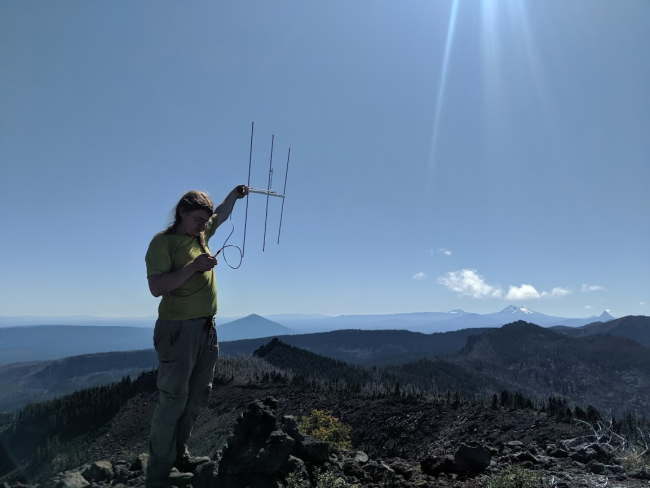 Image of me holding a yagi, courtesy of Will, KJ7FXU