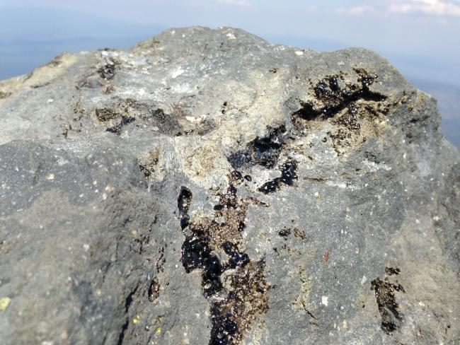 obsidian streaks on summit rocks